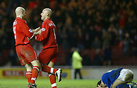 Photo. Andrew Unwin.Digitalsport<br /> Middlesbrough v Leicester City, Barclaycard Premier League, Riverside Stadium, Middlesbrough 17/01/2004.<br /> Middlesbrough's Danny Mills (l) and Massimo Maccarone (c) celebrate their 92nd minute equaliser as Leicester's John Curtis (r) lies on the floor distressed.