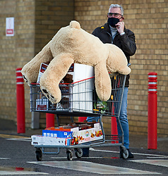 © Licensed to London News Pictures. 03/11/2020. Watford, UK. A shopper pushes a trolly fully of supplies and a giant teddy bear, from COSTCO in Watford, Hertfordshire ahead of a second national lockdown later this week. Strict measures are due to be re-introduced in an attempt to fight a second wave of the COVID-19 strain of Coronavirus. Photo credit: Ben Cawthra/LNP