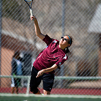 041513    Brian LEddy<br /> Rehoboth Lynx Kyree Sky serves the ball during a match against Gallup Monday afternoon.