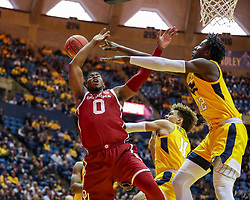 Feb 2, 2019; Morgantown, WV, USA; West Virginia Mountaineers forward Andrew Gordon (12) blocks a shot from Oklahoma Sooners guard Christian James (0) during the first half at WVU Coliseum. Mandatory Credit: Ben Queen-USA TODAY Sports