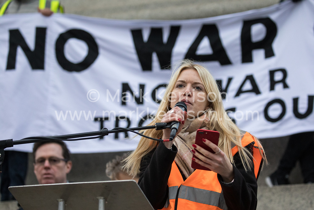 London, UK. 11 January, 2020. Shelly Asquith reads a statement on behalf of Rebecca Long-Bailey at the No War on Iran demonstration in Trafalgar Square organised by Stop the War Coalition and the Campaign for Nuclear Disarmament to call for deescalation in the Middle East following the assassination by the United States of Iranian General Qassem Soleimani and the subsequent Iranian missile attack on US bases in Iraq.