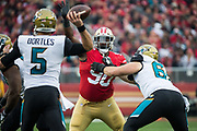 San Francisco 49ers defensive tackle Earl Mitchell (90) tries to block a pass by Jacksonville Jaguars quarterback Blake Bortles (5) at Levi's Stadium in Santa Clara, Calif., on December 24, 2017. (Stan Olszewski/Special to S.F. Examiner)