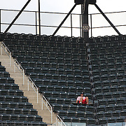 A lone fan wearing a New York Yankees hat watching the New York Mets V Miami Marlins, Major League Baseball game which went for 20 innings and lasted 6 hours and 25 minutes. The Marlins won the match 2-1. Citi Field, Queens, New York. 8th June 2013. Photo Tim Clayton