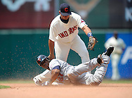 Craig Monroe of Minnesota slides safely into second base with a double as Jhonny Peralta takes a throw..The Minnesota Twins defeated the Cleveland Indians 4-2 on Sunday, July 27, 2008 at Progressive Field in Cleveland.