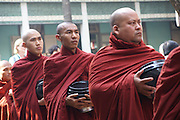 Myanmar, Amarapura, Mahagandayon Monastery, Buddhist Monks with bowls collect food donation for their meal
