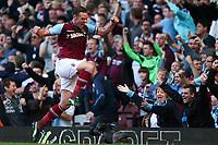 Football - Premier League - West Ham United vs. Sunderland<br /> West Ham's Kevin Nolan celebrates scoring, by jumping over the cameraman at Upton Park, London