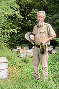 Rick Sutton, owner of Sutton Honey Farms in Lancaster, Ky., visits a bee yard at the Old Crow Inn and Chateau du Vieux Corbeau Winery, Tuesday, Sept. 8, 2020 outside Danville, Ky. (Photo by Brian Bohannon)