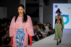 © Licensed to London News Pictures. 06/06/2018. LONDON, UK.  A model presents a look by Rosa Cameron from Edinburgh College of Art at the Best of Graduate Fashion Week 2018 show at the Old Truman Brewery in East London. The event presents the graduation show of up and coming fashion designers from UK and international universities.  Photo credit: Stephen Chung/LNP