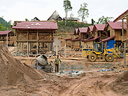 Vietnamese construction workers building the new village of Ban Sam Sang, Phongsaly province, Lao PDR. Four Laoseng ethnic minority villages will be relocated permanently to this new village before the end of 2015 due to the construction of the Nam Ou Cascade Hydropower Project Dam 6.