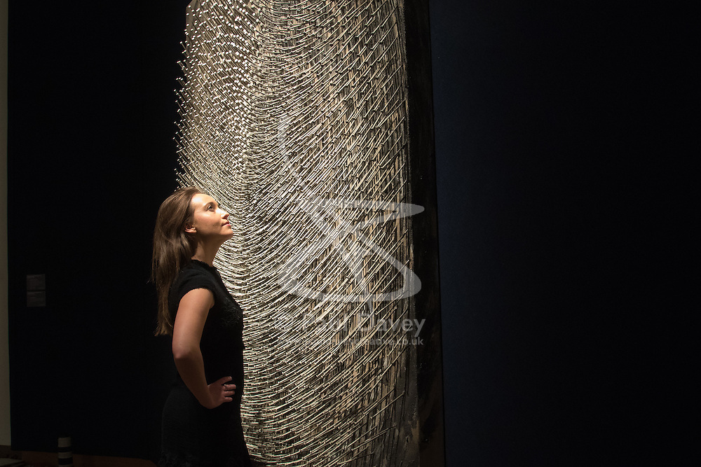 Christie's, London, March 3rd 2017. PICTURED: A woman admires the pattern and detail in Gunther Uecker's 'Spirale I, Spirale II (Doppelspirale), nails and latex paint on canvas laid down on wood, in two parts, accompanied by an artist's architectural drawing, which is expected to fetch between £1-1.5 million.  <br /> Fine art auctioneers Christies hold a press preview for their Post-War and Contemporary Art auctions to be held on March 7th and 8th.