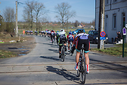 Evelyn Stevens of the Boels-Dolmans Cycling team rides through a level crossing during the 2015 Omloop Het Niewsblaad Dames race.