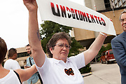 BIRMINGHAM, AL –SEPTEMBER 16, 2012: Maria Vuelta, an Undocubus rider, joins dozens of undocumented Hispanic demonstrators outside Sheraton Hotel in Birmingham, Alabama to protest during a briefing on the civil rights effects of state immigration law held by the U.S. Commission on Civil Rights in Birmingham, Alabama on August 17, 2012.