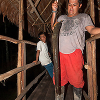 Juan Carlos Palomino, a native guide and part owner of the Amazon Refuge Wildlife Conservation Center, holds up a potentially deadly electric eel he caught in the nearby Yanayacu River.