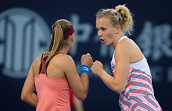 October 3, 2018 - Katerina Siniakova of the Czech Republic & Aleksandra Krunic of Croatia in action during their doubles match at the 2018 China Open WTA Premier Mandatory tennis tournament (Credit Image: © AFP7 via ZUMA Wire)