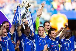 Retiring captain John Terry lifts the trophy (with Gary Cahill and David Luiz) as Chelsea celebrate winning the 2016/17 Premier League - Rogan Thomson/JMP - 21/05/2017 - FOOTBALL - Stamford Bridge - London, England - Chelsea v Sunderland - Premier League..