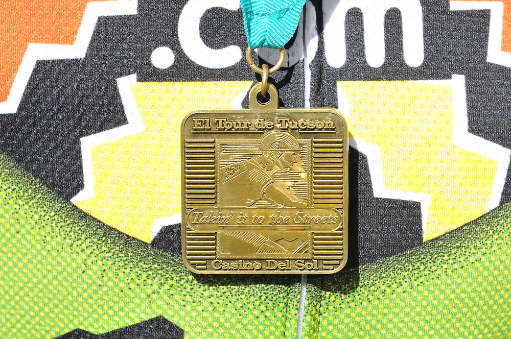 Gold medal awarded to 2017 Tour de Tucson finisher. Bike-tography by Martha Retallick.