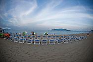 Deckchairs lined up on a beach of Nha Trang, Vietnam, Southeast Asia