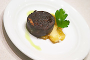 Finished dish: blood sausage with fried apples The Dolly Irigoyen - famous chef and TV presenter - private restaurant, Buenos Aires Argentina, South America Espacio Dolli