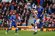 Ruben Loftus-Cheek of Chelsea jumps for a header with Ryan Shawcross of Stoke city. Premier league match, Stoke City v Chelsea at the Bet365 Stadium in Stoke on Trent, Staffs on Saturday 18th March 2017.<br /> pic by Andrew Orchard, Andrew Orchard sports photography.