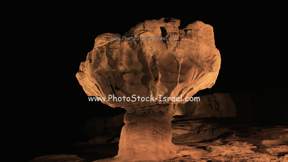 The mushroom rock at Timna valley is illuminated at night during an audio visual presentation. Photographed at Timna park, Israel