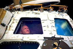"""Scott Kelly releases a photo on Twitter with the following caption: """"""""Happy Birthday, @Space_Station! Bittersweet final moment in the cupola before returning to Earth after my #yearinspace. Having spent 500 days of my life on ISS, I'm inspired if we can do this—the hardest thing we've ever done—we can do anything if we choose to & we work together."""""""". Photo Credit: Twitter *** No USA Distribution *** For Editorial Use Only *** Not to be Published in Books or Photo Books ***  Please note: Fees charged by the agency are for the agency's services only, and do not, nor are they intended to, convey to the user any ownership of Copyright or License in the material. The agency does not claim any ownership including but not limited to Copyright or License in the attached material. By publishing this material you expressly agree to indemnify and to hold the agency and its directors, shareholders and employees harmless from any loss, claims, damages, demands, expenses (including legal fees), or any causes of action or allegation against the agency arising out of or connected in any way with publication of the material."""