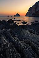 Bay with black rocks in Sardinia