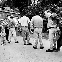 A FARC rebel seaches passengers for weapons at a vehicle checkpoint in Caqueta.<br />