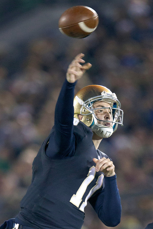 Notre Dame quarterback Tommy Rees (#11) delivers pass during second quarter of NCAA football game between Notre Dame and Boston College.  The Notre Dame Fighting Irish defeated the Boston College Eagles 16-14 in game at Notre Dame Stadium in South Bend, Indiana.