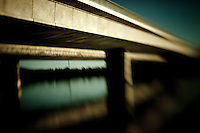 Abstract views of Commonwealth Avenue Bridge over Lake Burley Griffen and reflections in Canberra
