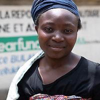 A young woman at a new reservoir build by IMA and Tearfund in a community near Butembo, Congo.