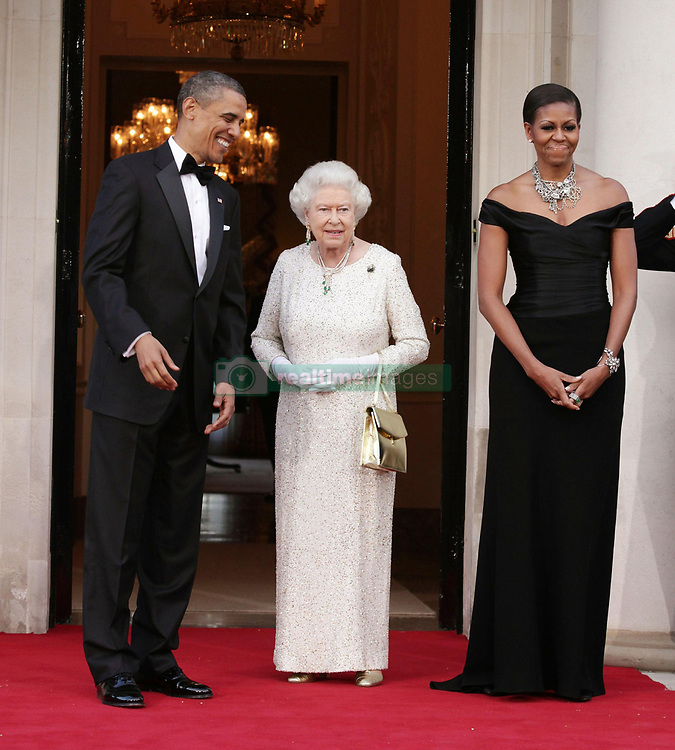 US President Barack Obama and First Lady Michelle Obama welcome the arrival of Queen Elizabeth II and the Duke of Edinburgh (not on picture) at Winfield House - the residence of the Ambassador of the United States of America - in Regent's Park, London, as part of the President's State Visit to the UK.
