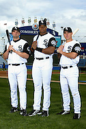 CHICAGO - 2002:  Paul Konerko #14, Frank Thomas #35 and Magglio Ordonez #30 of the Chicago White Sox pose for a portrait at Comiskey Park in Chicago, Illinois.  (Photo by Ron Vesely)