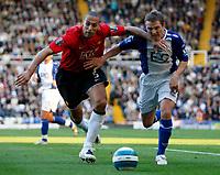 Photo: Richard Lane/Sportsbeat Images.<br />Birmingham City v Manchester United. The FA Barclays Premiership. 29/09/2007. <br />United's Rio Ferdinand tackles City's Gary McSheffrey.