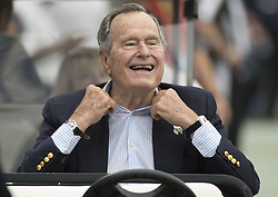 Former U.S. President George H.W. Bush sits on the sidelines before a game between the Houston Texans and Oakland Raiders where he served as honorary team captain for the Texans in Houston, TX, USA on November 17, 2013. Photo by George Bridges/MCT/ABACAPRESS.COM