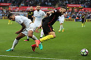 Nicolas Otamendi of Manchester city ® is challenged by Kyle Naughton of Swansea city. Premier league match, Swansea city v Manchester city at the Liberty Stadium in Swansea, South Wales on Saturday 24th September 2016.<br /> pic by Andrew Orchard, Andrew Orchard sports photography.