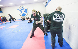 Alan punches the pads, as Stef Noij, KMG Instructor from the Institute Krav Maga Netherlands, takes the IKMS G Level Programme seminar today at the Scottish Martial Arts Centre, Alloa.