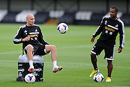 Swansea city's Jonjo Shelvey (l) in action . Swansea city FC team training in Llandore, Swansea,South Wales on Thursday 15th August 2013. The team are preparing for the opening weekend of the Barclays premier league when they face Man Utd. pic by Andrew Orchard,  Andrew Orchard sports photography,