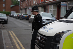 May 29, 2017 - Manchester, England, United Kingdom - Police officers guard a cordoned off street, a place where part of the investigation in to the Manchester Arena explosion is taking place, in Manchester, United Kingdom, Monday, May 29, 2017. Greater Manchester Police are treating the explosion, which has killed 22 people, after the Ariana Grande concert, which took place on 05/22/2017 at Manchester Arena, as a terrorist incident. (Credit Image: © Jonathan Nicholson/NurPhoto via ZUMA Press)