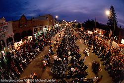 Sturgis at Night, SD. 1998<br /> <br /> Limited Edition Print from an edition of 50. Photo ©1998 Michael Lichter.<br /> <br /> The Story: Some bikers come to Sturgis every August for 10-days, others for just a day or two.  Some come to be spectators or race, others to tour the hills and the Bad Lands. They come to meet up with friends, take in a concert, or just to party. But no matter what brought them to Sturgis, every biker is drawn to Main Street, as if it were the epicenter of the bike world. Riding it has become an annual ritual, without which, the trip wouldn't be complete.