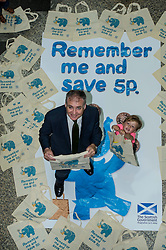 Environment minister Richard Lockhead launced a new public awareness campaign ahead of the introduction of a 5p charge for each single use carrier bag given to shoppers. Mr Lockhead was joined by Isaac Lee (aged 3)  at the launch. Edinburgh,  25 September 2014 Ger Harley | StockPix.eu
