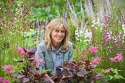 Chris Marchant amongst her plants at Orchard Dene Nursery