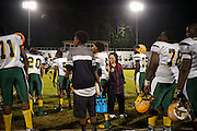"""BIRMINGHAM, AL – SEPTEMBER 11, 2015: Sonya Whitaker (center) returns from speaking with Quintarius Monroe on the sidelines of a high school football game. """"I'm here to make sure he doesn't get in trouble,"""" Whitaker said. As a type 1 diabetic, Quintarius Monroe requires frequent blood sugar testing and supervision when self-administering insulin. When care from qualified personnel at his school in Center Point became unavailable, Monroe was forced to transfer several miles away from his locally zoned school to attend Woodlawn High School. The Americans with Disabilities Act requires schools to provide """"reasonable accommodation"""" for students with medical conditions, but given that most schools no longer retain school nurses, many schools are failing to provide adequate care for their students.<br /> CREDIT: Bob Miller for The New York Times"""