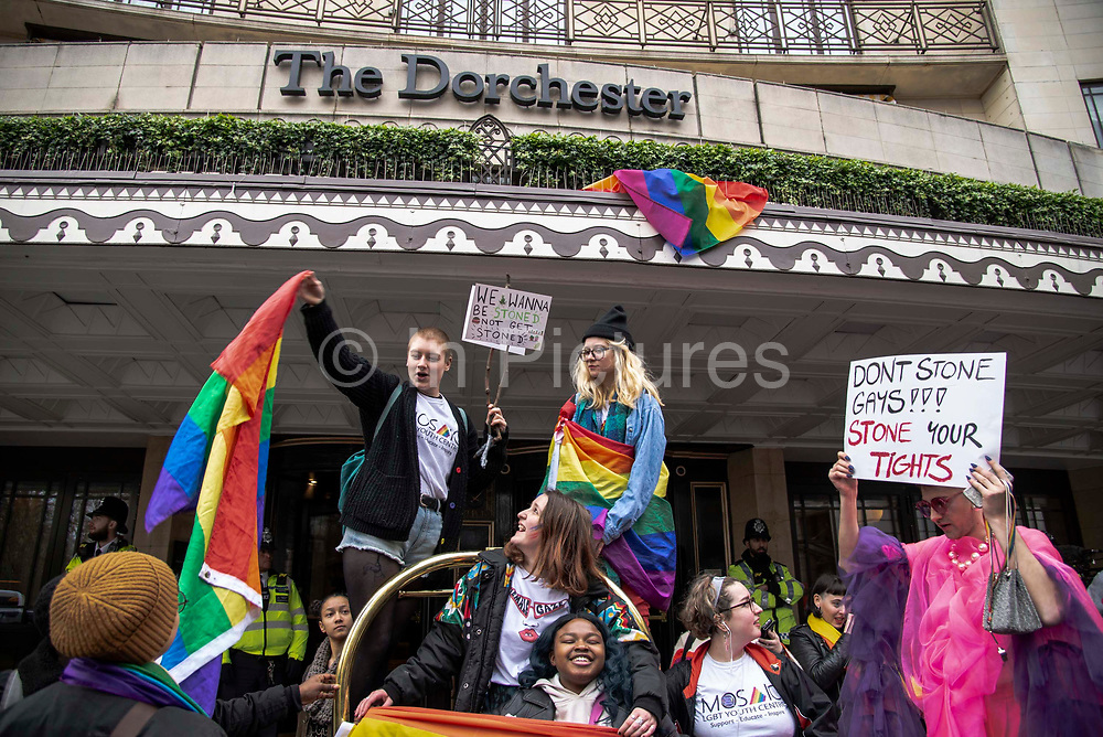 Demonstrators gather outside the Dorchester Hotel in Park Lane in London, England, United Kingdom on 6th April, 2019 to protest against new Islamic criminal laws ratified by  the Sultan of Brunei punishing homosexuality by stoning offenders to death. The hotel is owned by the Sultan of Brunei.