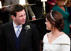 Princess Eugenie and her groom Jack Brooksbank, look at each other during their wedding ceremony at St George's Chapel in Windsor Castle.