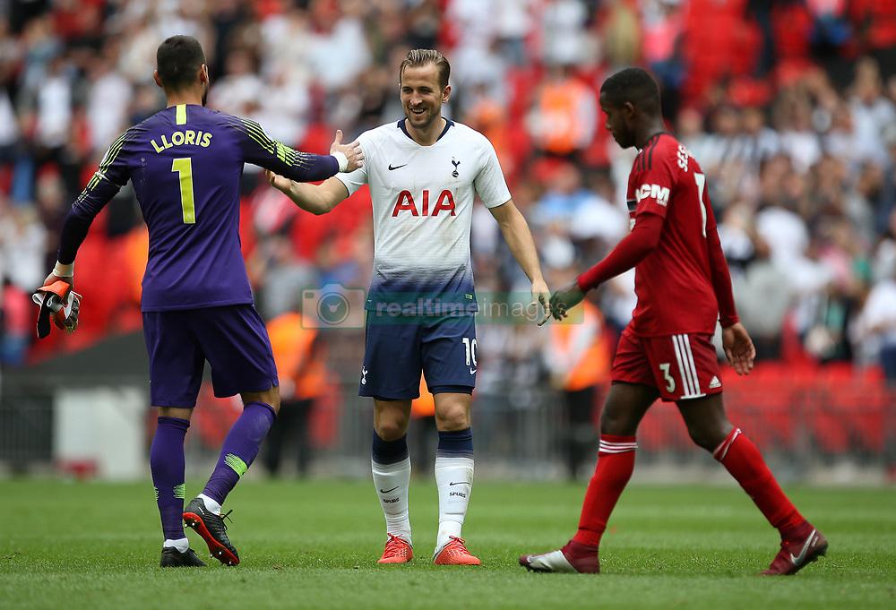 Tottenham Hotspur's Harry Kane with Hugo Lloris after Fulham's Ryan Sessegnon walks past at full time