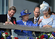 © Licensed to London News Pictures. 02/06/2012. London, UK. HRH Queen Elizabeth on the balcony of the Royal Box at The Investic Derby Festival today 2nd June 2012. The Royal Jubilee celebrations. Great Britain is celebrating the 60th  anniversary of the countries Monarch HRH Queen Elizabeth II accession to the throne this weekend Photo credit : Stephen Simpson/LNP