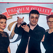 "Raife Aytek,Baroness Jan Royall present Bira London Best Takeaway in London award to winner ""Pizza King Kebab House"" at the 5th British Kebab Awards on 26th Feb 2017 at Park Plaza Westminster ,London,UK. by See Li"