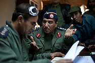 Citizens and soldiers meet to discuss at an army base in Benghazi on Feb. 26, 2011.