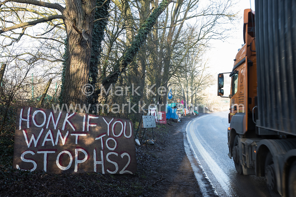 Harefield, UK. 21 January, 2020. A sign inviting passing motorists to sound their horns at the Save the Colne Valley Stop HS2 wildlife protection camp on Harvil Road. Activists reoccupied the field behind the roadside camp on 18th January in order to seek to protect ancient woodland set to be destroyed by HS2.