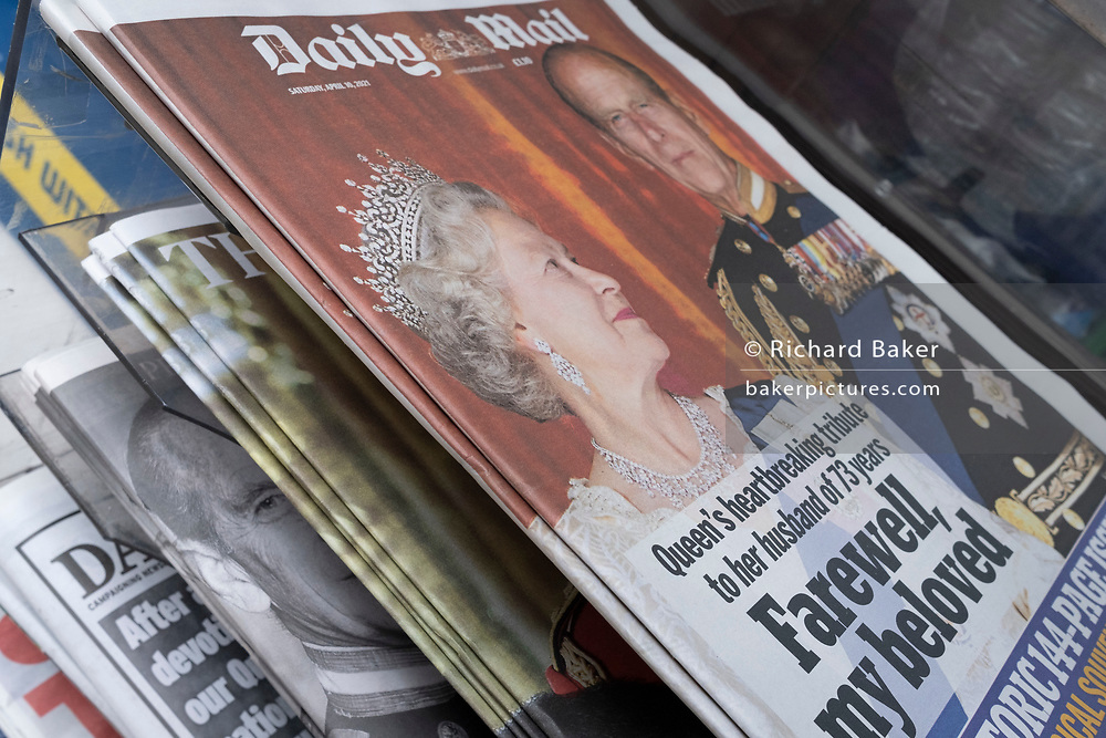 The day after the death at age 99 of Prince Phillip, the Duke of Edinburgh, consort to Queen Elizabeth II, his face is on the front pages of all newspapers near Windsor Castle, on 10th April 2021, in London, England.